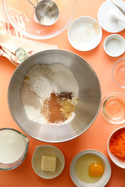 Dry ingredients for gluten free carrot cake cinnamon rolls in a mixing bowl.