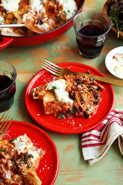 The best weeknight lasagna dinner served on a small red plate.