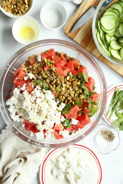 All ingredients for an easy watermelon salad in a large bowl.